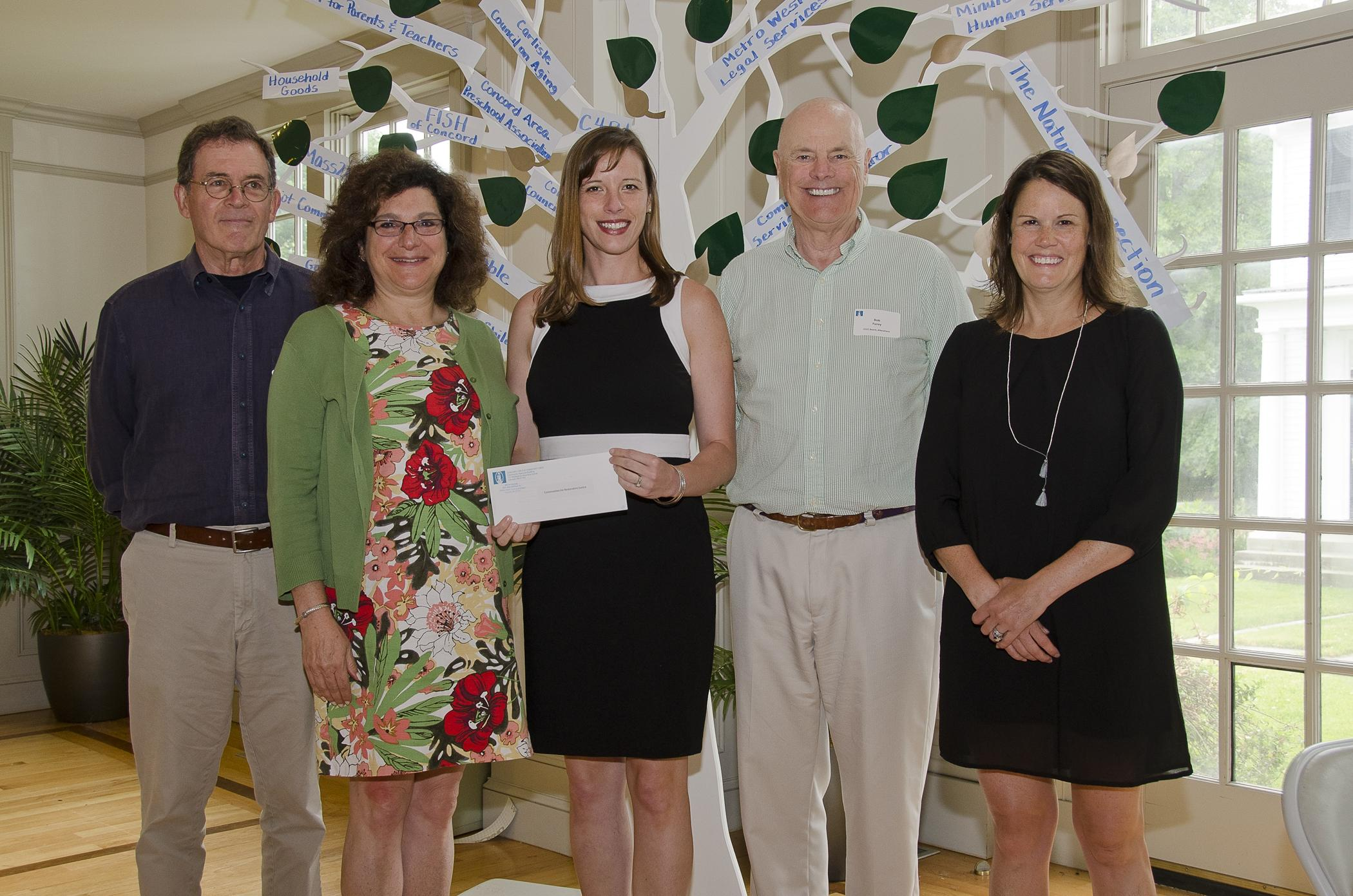 Community Chest Grant Allocations Team Members Present The Award Letter To Communities For Restorative Justice (C4RJ). Left To Right Are Jim Carter, Chest Grant Team Member; Lauren Rosenzweig Morton, C4RJ Board President; Erin Freeborn, C4RJ Executive Director; Bob Furey, Chest Grant Team And Board Member; And Ali Sullivan, Chest Grant Team Member. Courtesy Photo / Harley Freedman