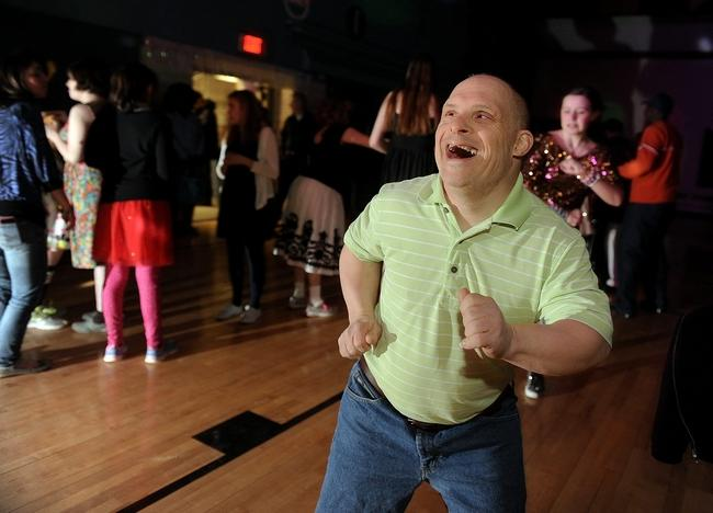 "Brian Fruscione, Of Concord, Finds His Groove During The ""Sneaker Prom,"" Sponsored By The Concord Based Organization Friday Night Fun Night, Which Is A Group Of Parents And Their Developmentally Disabled Children, Many Of Whom Are Adults, On Friday Night, March 13, 2015 At The Sudbury Recreation Complex. Wicked Local Staff Photo/David Gordon"